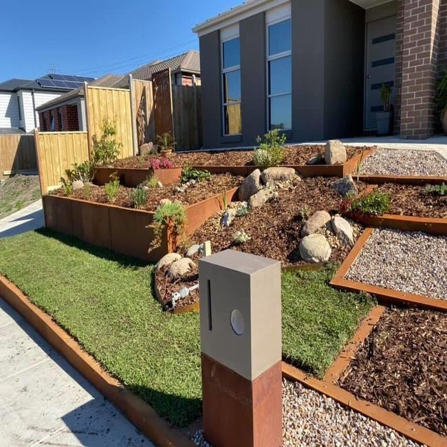 A front lawn with some timber retaining wall systems set up, at a home in Melbourne.