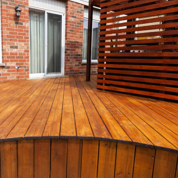 An outdoor wooden timber decking