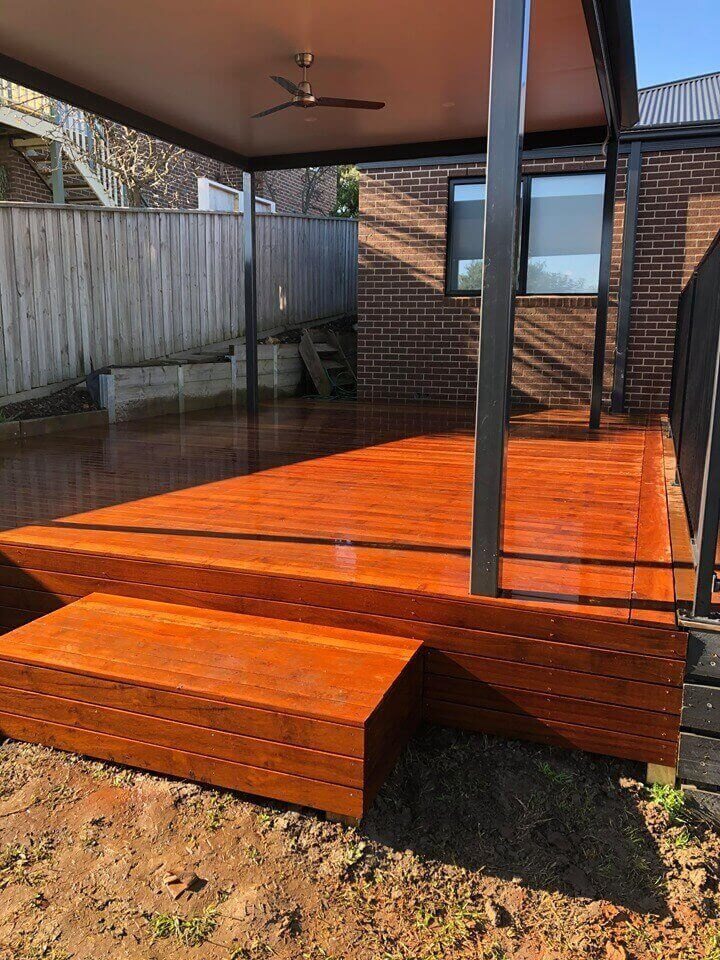 A timber decking with a pergola.