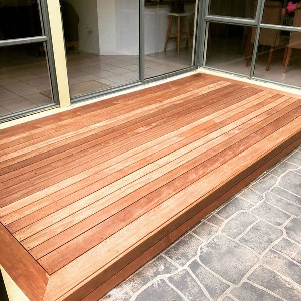 A small timber decking connected to the house.