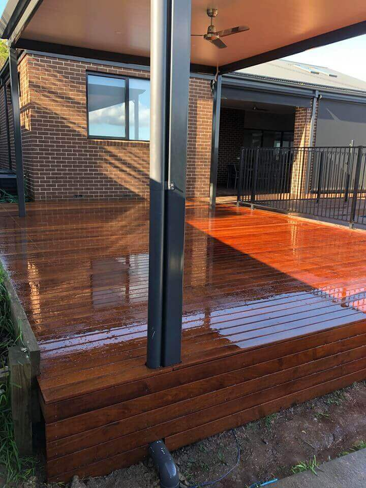 A polished, timber decking constructed in a south eastern suburbs backyard.