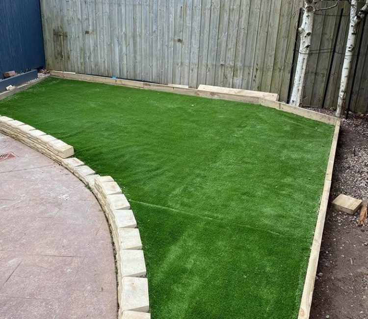 Artificial green turf in a wooden, corner, boxup.